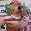 Swampscott's Bonnie Brown gives Pirate Pete a hug.