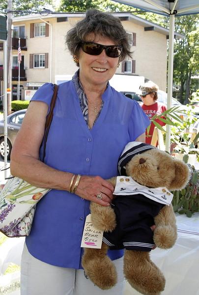 Saugus Garden Club president Donna Manoogian takes home a Sailor Bear.
