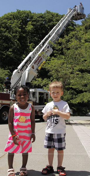 Two year old Emily Bryson and Michael Patriaca are under Ladder 21 which holds Michael's dad and Fire Lt. Joe Gambale.