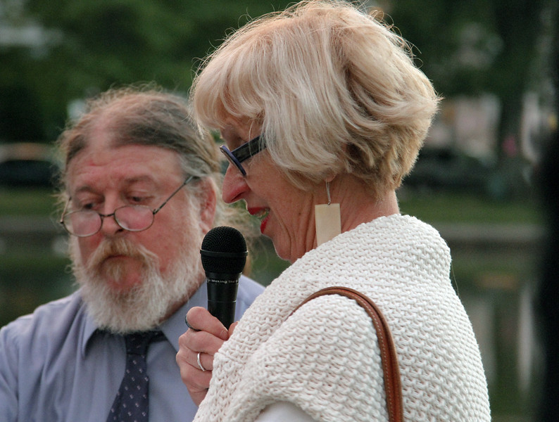 Paul Coombs, who served as master of ceremonies, helps Rosemie Leyre through her dedication.
