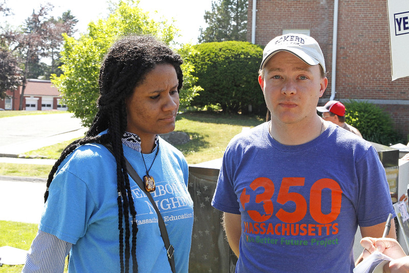 Estella Diaz and Craig Altemose, director of Mass 350, distribute some information.