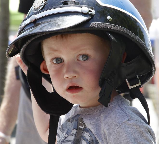 R.J.Kearns (2) wears the helmet of Swampscott Policeman Sal Caruso.