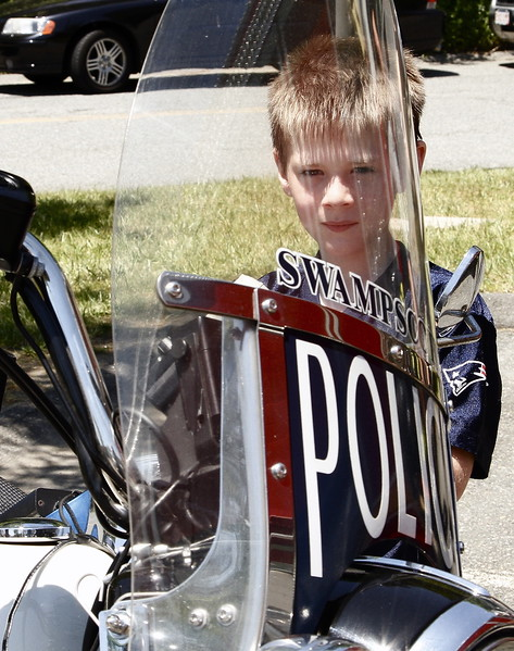 Matthew Chatterton looks through the windscreen of a Swampscott Police motorcycle.