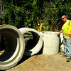 "Swampscott. ""The Pad"" at Swampscott Cemetery on <br /> Essex Street. Steve Alex, Beverly, a DPW worker, looks at the catch basins that are going to be used for fire pits on the beach in Swampscott.  Several are mini catch basins."