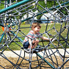 "Revere, the Louis ""Cheako""Ciarlone Tot Lot.  Ryder Brennan, Revere, aged 3 came to the playground his family.  He is exploring ""the spiderweb"""