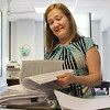 Karen Richard, administrative assistant, looks through nomination papers at Lynn City Hall today. Photo by Owen O'Rourke