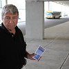 Billy Bell with a bus schedule, taken in the MBTA bus station in Revere. Photo by Owen O'Rourke