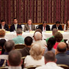 Councilor-at-large candidates, from left, Buzzy Barton, Daniel Cahill, Brendan Crighton, Paul Crowley, Miguel Funez, Hong Net, Aikaterina Panagiotakis Koudanis, and Robert Clay Walsh debate during a candidate forum at Congregation Ahabat Sholom on Wednesday, July 10. Item Photo / Angela Owens.