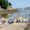 Marblehead.  A languid summer afternoon on a little beach adjacent to Fort Sewall. Children exploring tide pools and swimming.  Low tide provides a beach that is gradually covered as the tide comes in.