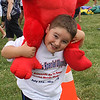 Nikolas Agganis shows off the red monkey he won at the 7th annual Agganis Special Olympics held at Saugus High School on Saturday July 14. Photo by Owen O'Rourke