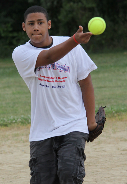 Gouchet Porcher pitching in the softball game just before the opening ceremonies at the 7th annual Agganis Specil Olympics held at Saugus High SChool on Saturday July 14. Photo by Owen O'Rourke