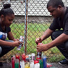Latisha and Terrel Payne light candles at a vigil for their brother, Brandon Payne, on the one year anniversary of his death on Tuesday, July 23. Item Photo / Angela Owens.