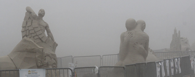 Sand sculptures shrouded in fog on Revere Beach today. Photo by Owen O'Rourke