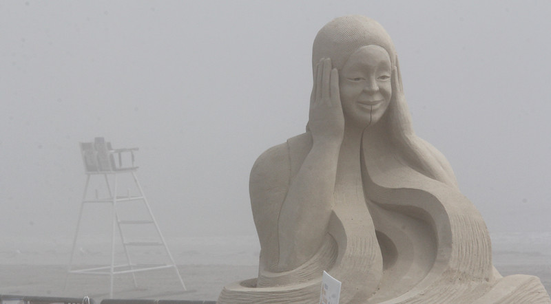 """The sand sculpture """"Sound Wave"""" by Sandis Kondrats Shouded in fog on Revere Beach today. Photo by Owen O'Rourke"""