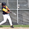 Pine Hill's Javien Delgado (9) swings during their game against Nahant at Walter Flynn Field on Thursday, July 5. Item Photo / Angela Owens.