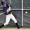 Nahant's Max Carbone (12) swings during their game against Pine Hill at Walter Flynn Field on Thursday, July 5. Item Photo / Angela Owens.
