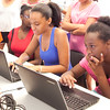 """Laury Martinez, 13, and Maysie Jean-Louise, 13, design bracelets that will be created through a 3D printer, during the """"coding party"""" at Girls Inc. on Thursday, July 31. Item Photo / Angela Owens."""