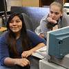 Darlee Chavez, left, and Angelik Elswick, right, from Lynn, are two of the 31 students enrolled in an engineering class at North Shore Community College this summer. Photo by Owen O'Rourke