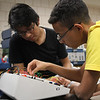 Omar Gomez,left, and Alecio Dasilva, right, of Chelsea, run tests on a proto board in an engineering class at North Shore Community College. Photo by Owen O'Rourke