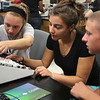 Victoria Butler, left, Carrera Dean, and Scott Rochon, right, of Peabody, run tests on a proto board at an engineering class at North Shore Comminty College today