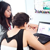 """Leticia Lopez-Nebitez, 22, helps Marissa Boulter,15, learn about animation during the """"coding party"""" at Girls Inc. on Thursday, July 31. Item Photo / Angela Owens."""