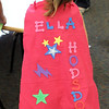 Ella hodsdon with the super hero cape she just made in the children's room at the Lynnfield Public Library today. Photo by Owen O'Rourke