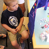 Kevin Geary is about to try on the cape he made in the childrens room at the Lynnfield Public Library. Photdo by Owen O'Rourke