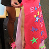 Ella Hodsdon tires her new cape on for the first time after making it in the children's room of the Lynnfield Public Library today.
