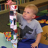 Andrew Geary was more interested in building structures with blocks that he was in building super hero capes in the children's room at the Lynnfield Public Library. Photo by Owen O'Rourke