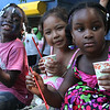 From left to right: Blessing  Zian, Anita Chen, and Ariana Soares enjoy Italian Ice at the Mayor's cookout fun day at Gallagher Park in Lynn on Thursday, August 9. Photo by Owen O'Rourke