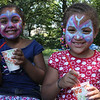Elianny Reyes, left, and Esmery Valdez, right, enjoy Italian Ice at the Mayor's cookout and fun day at Gallagher Park in Lynn on Thursday, August 9. Photo by Owen O'Rourke