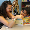 "Emily Horsdori, United Way of Massachusetts Bay and Merrimack Valley, left, and Doaa Abdelnlabi, right, read at the Summer Learning Collarborative held at Girl's Inc. on Thursday, August 9. Photo by Owen O""Rourke"