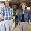 Howard Freedman, left, and Kelie Federman pose for a photo in the Beach Sales showroom in Revere on Thursday, August 9. The appliance and electronics store is gearing up for the sales tax holiday. Item Photo / Angela Owens.