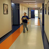 Mariela Alvarez, office manager at KIPP Academy in Lynn, walks down the hall of the Middle School section of the new school in Lynn. Classes begin August 20. Photo by Owen O'Rourke