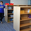 Alexis Estrella, The Development Associate at KIPP Academy, standing in the library of the new School. This is the first time KIPP in Lynn has had a library. The new school is on the verge of opening.  Photo by Owen O'Rourke