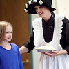 Charlotte Andrews, 9, and actress Carole Finn-Weidman act out an Amelia Bedelia story at the Swampscott Public Library on Thursday, August 9. Item Photo / Angela Owens.