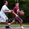 Bryan Arias (4) guards Michael Cerulli (4) at the Lynn Parks and Rec middle school basketball championships at Marian Gardens on Thursday, August 9. Item Photo / Angela Owens.
