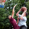 Jorman Almanzar blocks a shot by CJ Lights at the Lynn Parks and Rec middle school basketball championships at Marian Gardens on Thursday, August 9. Item Photo / Angela Owens.