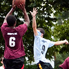 Anthony Silfa (6) takes a shot while Paul Kelly (9) attempts to block, at the Lynn Parks and Rec middle school basketball championships at Marian Gardens on Thursday, August 9. Item Photo / Angela Owens.
