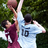 Michael Cerulli (4) takes a shot, while CJ Lights (10) attempts to block, at the Lynn Parks and Rec middle school basketball championships at Marian Gardens on Thursday, August 9. Item Photo / Angela Owens.