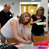 """English High School in Lynn held a training session for facilitators for freshman orientation. Tim Culliname, Allison Mosho, both teachers at English, and junior Mish Sencabaugh fill out an ice breaker form called """"Did you know.."""""""