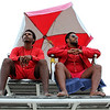 Revere DCR lifeguards Francisco Fresco, left, and Hearique Santos on lifeguard statnd number two scanning the water at Revere Beach, even in the rain.Lifeguards spend a lot of their time watching for people in trouble both on land and in the water.  Photo by Owen O'Rourke