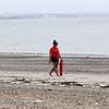 Revere DCR lifeguard Samantha Carter patroling Revere Beach. Photo by Owen O'Rourke