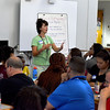 Jennifer Mancaniello the vice principle at English High School leads the training session for the facilitators of freshman orientation.  Eighty volunteers attended.