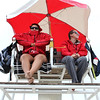 Revere DCR lifeguards Maria Vargas, left, and Meagan Sullivan, right, on chair three where they spend a lot of time looking for people in trouble. Many time its cold. Photo by Owen O'Rourke