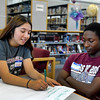 English High School in Lynn held a training session for facilitators of freshman orientation. Marilyn DeLeon and Denzell Bogues work on suggesting new ice breaker activities.