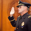 Sergeant Glenn Dunnigan is sworn in during a promotion ceremony at the mayor's office in Lynn City Hall on Tuesday, August 11. Item Photo / Angela Owens.