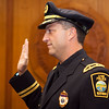 Captain Michael Vail is sworn in during a promotion ceremony at the mayor's office in Lynn City Hall on Tuesday, August 11. Item Photo / Angela Owens.