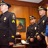 Sergeant Patrick McGuire is sworn in, while Lieutenant Glenn Dunnigan, Lieutenant Michael Vail, and Mayor Judy Flanagan Kennedy look on, during a promotion ceremony at the mayor's office in Lynn City Hall on Tuesday, August 11. Item Photo / Angela Owens.