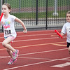 Gabby Hendy, 7, and Kelsey Kwiatek, 5, compete in a relay race during the kids track event at Manning Field on Tuesday, August 12. Item Photo / Angela Owens.